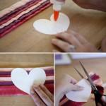 Вырежь из бумаги трафарет сердца и приклей к нему полученное полотно из полос.
