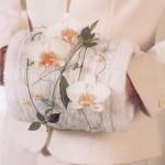 Теплая муфта с цветочными украшениями