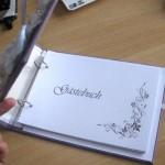 Дыроколом сделай отверстия и вставь листы бумаги в книгу. На первой странице напиши имена молодоженов или просто поставь инициалы