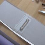 Вырежь бумагу по размерам папки и оставь по 2 см с каждой стороны на подгиб