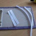 Отрежь 2 ленты по 10-12 см и 2 ленты еще длиннее