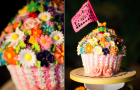 unique-wedding-reception-ideas-beyond-wedding-cake-1colorful-cupcake-tree__full-carousel