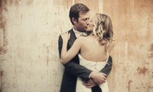 all-down-wedding-hair-loose-waves-bride-groom-kiss__full-carousel