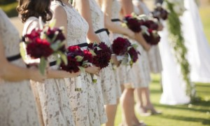 lace-printed-bridesmaids-dresses-black-sash-red-bouquets__full-carousel