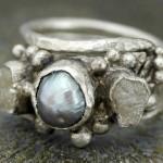 Жемчужина и алмазы в кольце невесты