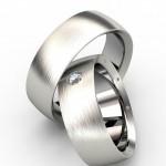 Свадебные кольца украшенные бриллиантом